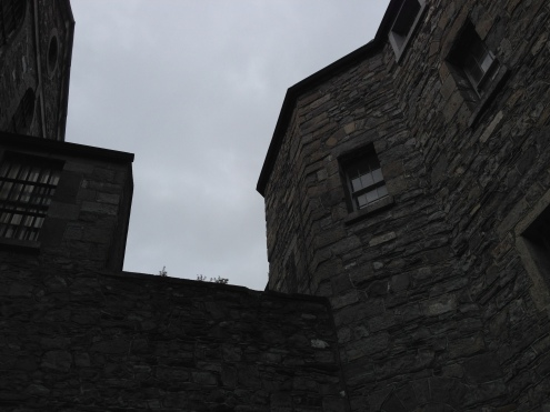The oppressive walls of the jail.