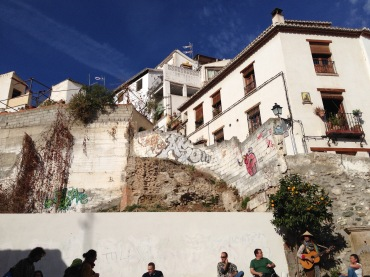 """A busker singing """"What A Wonderful World"""" on the side streets of Calle Elvira, Granada."""