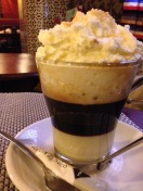 A rich coffee with condensed milk and almonds in Granada, Spain.