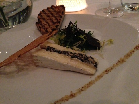 Black truffle stuffed brie cheese.