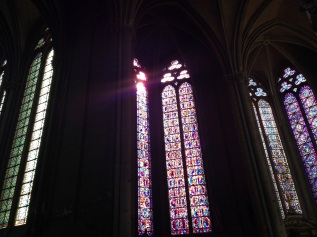 The beautiful stained glass looked majestic with the sun.