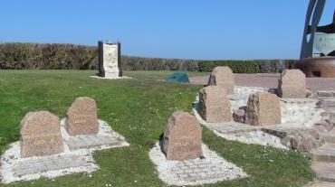 Small headstones at La Flamme Memorial at Sword Beach.