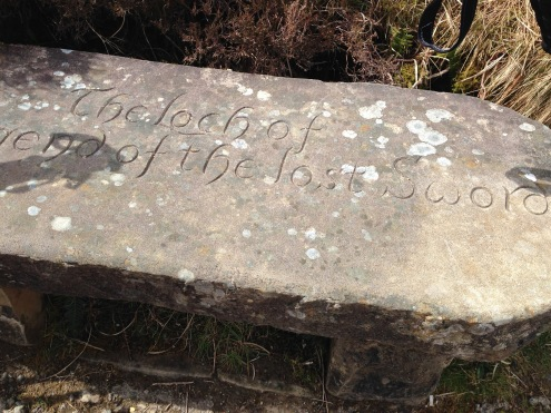 A bench notating the Loch of the Lost Sword.