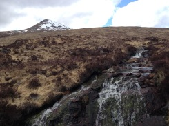 Snow capped mountains and waterfalls in the moor.