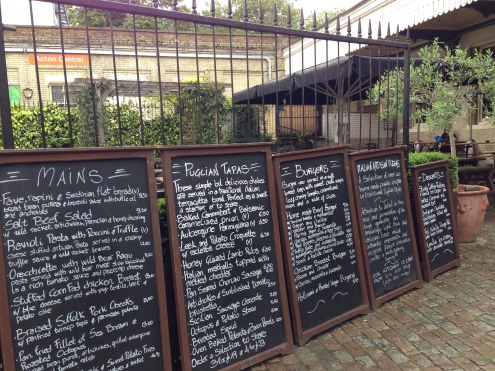 The chalkboard menus mounted outside.
