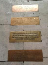 Numerous plaques for Queen Elizabeth II.