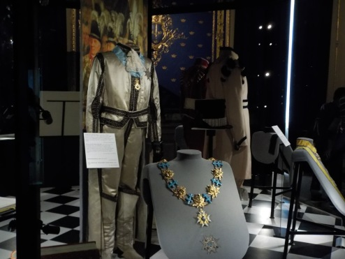 Metals and uniforms on display inside the palace.