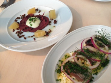 Reindeer heart with pickled beets and herring with red onion.