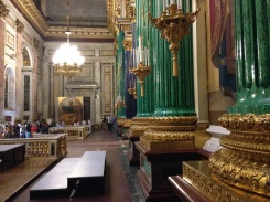 The emerald green columns surround the alter inside the cathedral.
