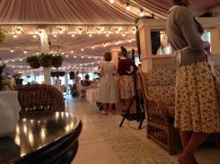 Waitresses dressed in full, patterned cotton dresses.