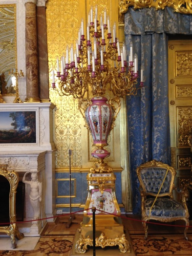 A gorgeous, pink vase in a blue state room.