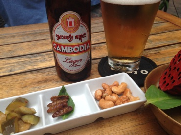 The local beer with munchies: cashews, pickles, and silk worms.