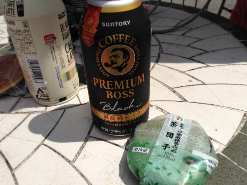 Our first Japanese meal: iced black coffee in a can and green matcha tea mochi.