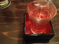 They overpour the sake into the box so you have the glass and box to slurp from.