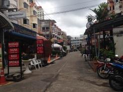 Massage parlors and bars along Patak Road.