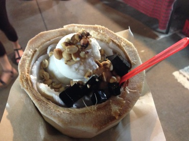 Coconut ice cream with peanuts and grass jelly.