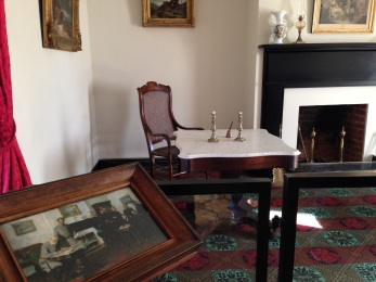 The painting is for reference to see where the men sat and signed.